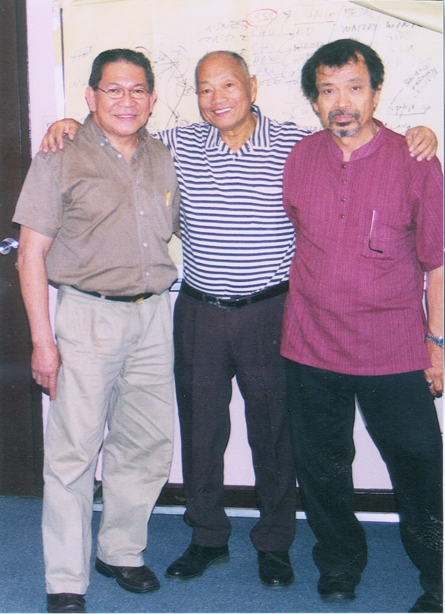 GM Johnny F. Chiuten with Dr. Jopet Laraya, martial arts master in HK, and Rene J. Navarro, 5 years ago, in the University of the Philippines.